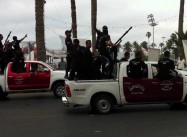 Despite Airport Incident, Henry Kissinger is Wrong about Libya