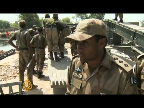 Bombings Kill 32 in Pakistan NW; <br/> US Drone Strikes Kill 20; <br/> As Floods Advance on Sindh