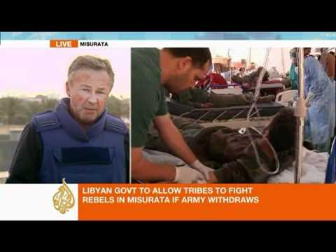 Fighting Rages in Misrata despite Withdrawal Pledge