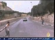 Israeli Settler Runs over Protesting Palestinian Children