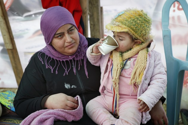 Mariam-Abu-Madegham-Al-Turi-sits-with-her-niece-in-her-familys-tent.-629x419