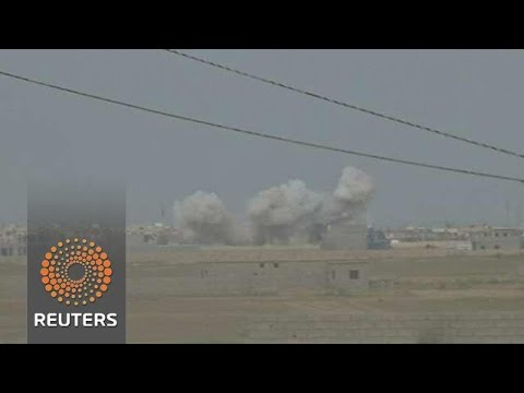 US Air Strikes Split Iraq Coalition aiming to Take Tikrit