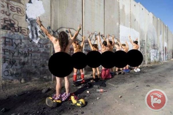 Activists strip against Israeli separation wall in Bethlehem