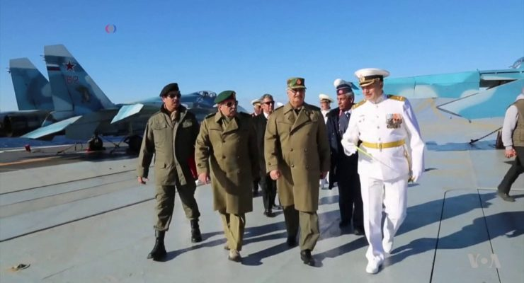 Is Russia trying to take back over Libya from NATO, Radicals?