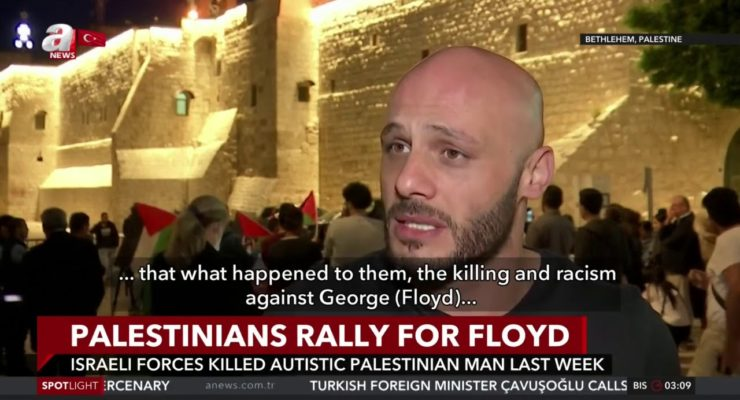 'I am here with my Palestinian flag to show that Black Lives Matter'
